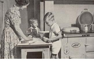 Old photograph of family around an AGA cooker
